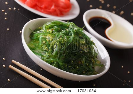 Wakame Seaweed Salad With Sesame Seeds On A Table. Horizontal