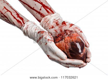 Operation And Medicine Theme: Bloody Hand Surgeon Holding A Human Heart In A Bloody White Gloves I