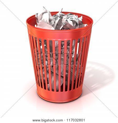 Red trash bin full of crumpled paper
