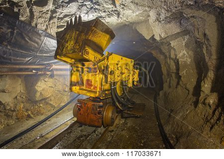 Underground gold mine tunnel passage ore loading machine