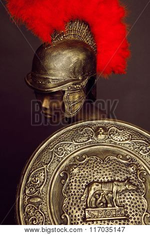Studio shot of mannequin in armor and in helmet with feathers