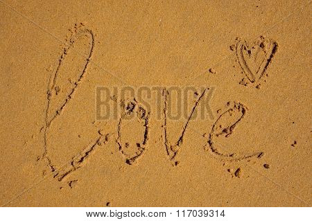 Love Word Written On Brown Sand