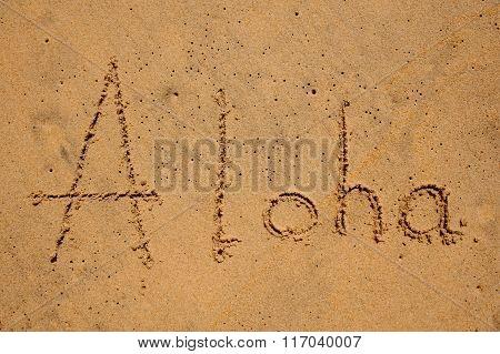 Inscription Aloha On Sandy Beach
