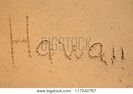 The Word Hawaii Is Written In The Sand
