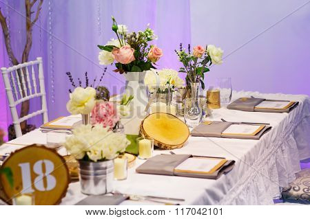 Elegant table set in green and white for wedding or event party.
