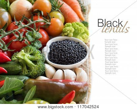 Uncooked Black Lentils In A Bowl With Vegetables