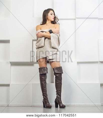 girl in sweater and boots