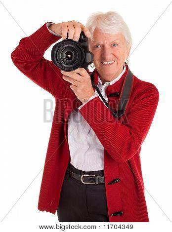Senior Female Photographer Shooting You