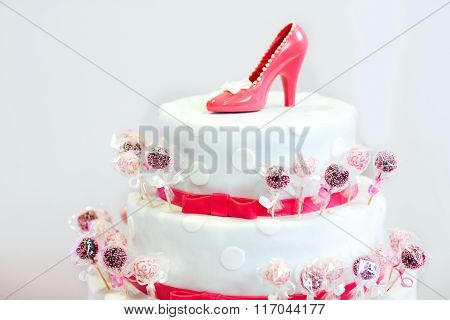 Delicious beautiful wedding cake in white and red with cake pops