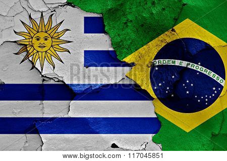 Flags Of Uruguay And Brazil Painted On Cracked Wall
