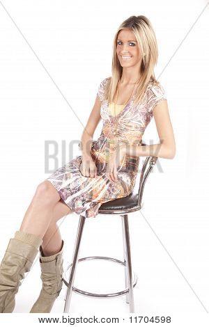 Woman Sitting On Barstool