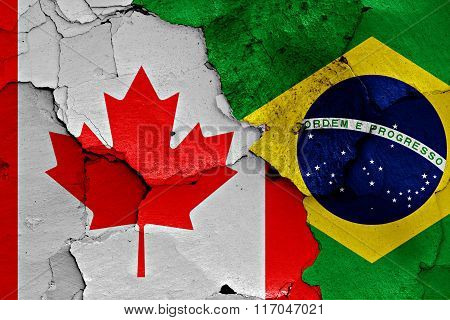 Flags Of Canada And Brazil Painted On Cracked Wall