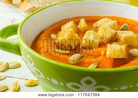 Pumpkin Soup In A Green Bowl Close Up