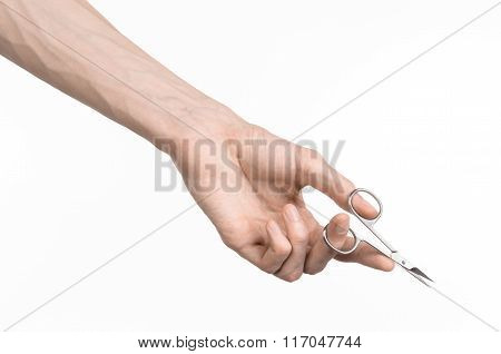 Health And Personal Care: Hand Holding Scissors For Manicure Isolated On White Background