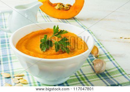 Pumpkin Creamy Soup In A White Bowl