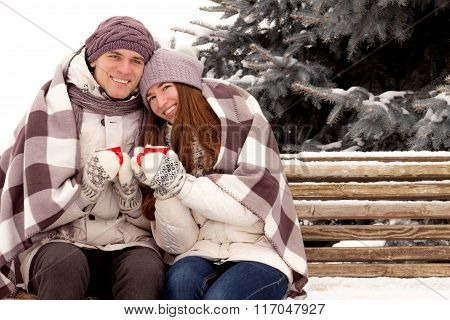 Happy Couple In Love With Cup Of Coffee In Park In Winter