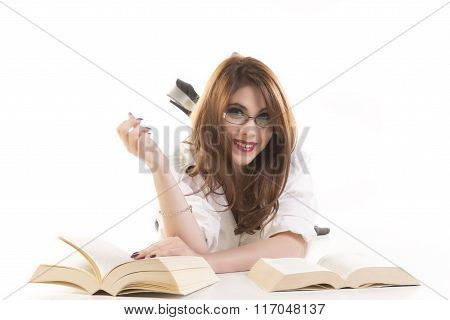 Smiling Woman With Books Lying On Floor