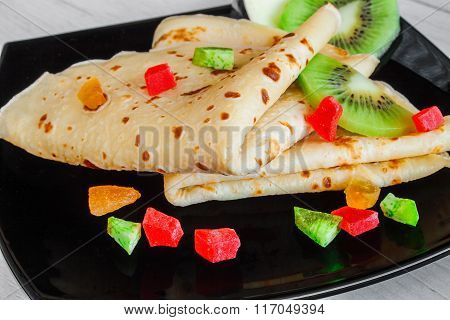 Folded pancake with fruits
