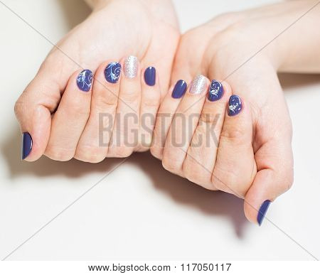 Female Hands With Professional Blue And Silver Manicure