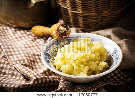 Mashed Potatoes  And Raw Potato In The Basket