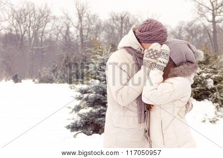 Kissing Couple In Park In Winter