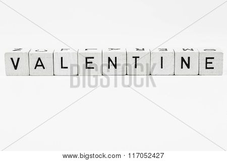 The word valentine made of wooden cubes