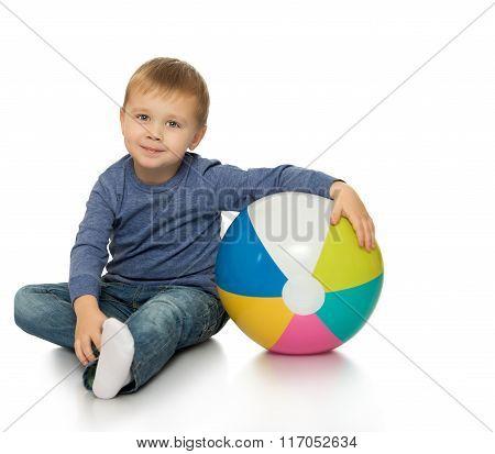 Little boy hugging the ball