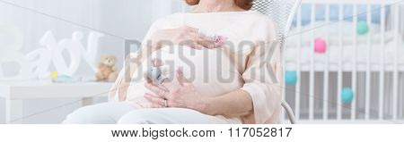 Pregnant Elderly Woman Touching Belly
