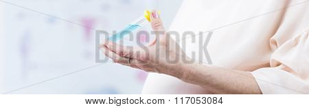 Pregnant Female Holding Test Tube