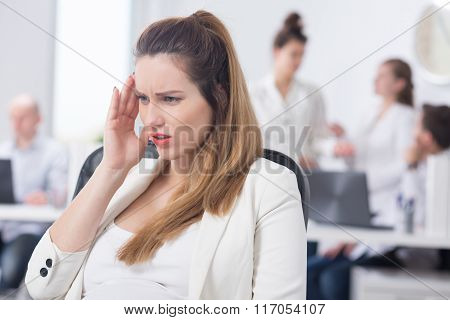 Office Worker With Pregnancy Symptoms