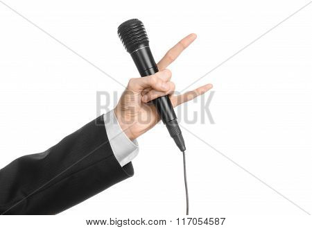 Business And Speech Topic: Man In Black Suit Holding A Black Microphone Isolated On White Background