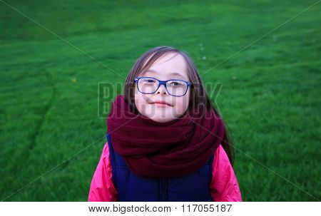 Portrait Of Beautiful Girl With Glasses In The Park