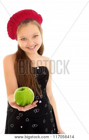 The girl holds out an Apple