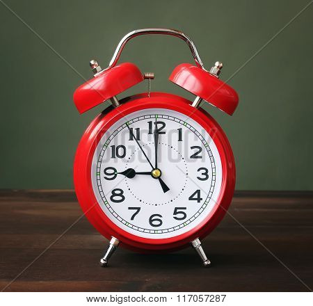 The Red Alarm Clock Showing 9-00 Hours.