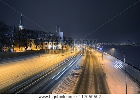 Panorama Of Night Riga In Winter With Krasta Street Covered In Snow