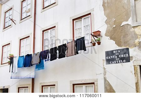 Laundry Hanging To Dry Outside A House Facade In Alfama District Lisbon, Portugal, Europe