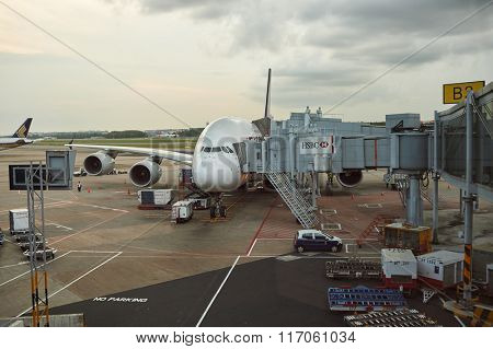 SINGAPORE - NOVEMBER 03, 2015: A380 docked at Changi Airport. Singapore Changi Airport, is the primary civilian airport for Singapore, and one of the largest transportation hubs in Southeast Asia