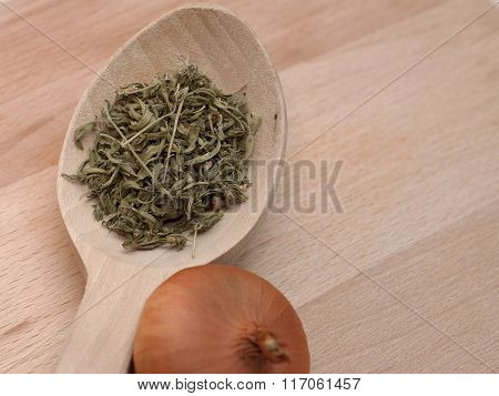Wooden Spoon With Onion And Savory