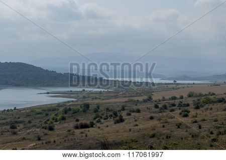 View of largest  reservoir Ogosta gather water with fisherman in shore