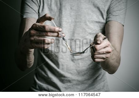 The Fight Against Drugs And Drug Addiction Topic: Addict Holding Spoon Lighter And Heats The Liquid