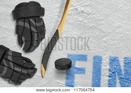 Finnish Stick, Gloves And Puck On Ice