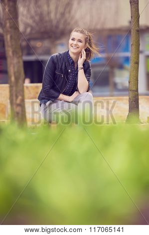 Smiling Cheerful Woman Relaxing On Fresh Air