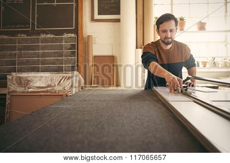 Man working at his workbench with concentration
