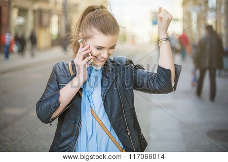 Successful Woman Talking On The Phone On The Street