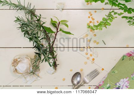 Garlic And Herbs On A Cream Background