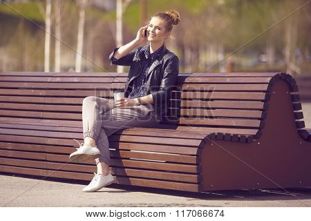Smiling Woman Talking On The Phone On Fresh Air