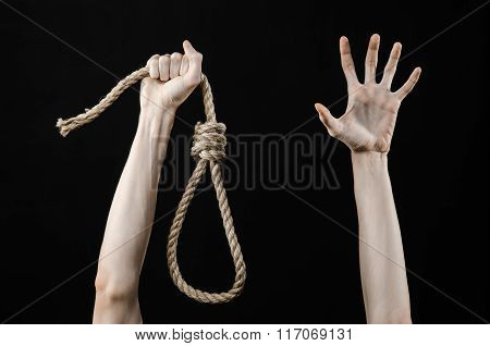 Lynching And Suicide Theme: Man's Hand Holding A Loop Of Rope For Hanging On Black Isolated Backgrou