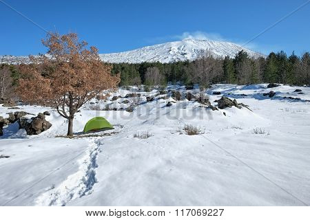 green tent in the snow of Etna National Park, Sicily