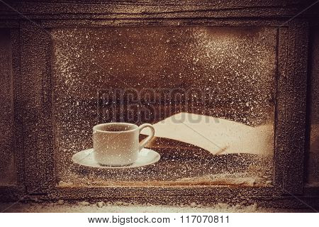 Hot Cup Of Coffee For The Frozen Winter Window.
