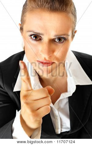 Strict modern business woman shaking her finger isolated on white